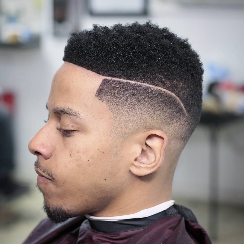 Fade with lines black haircut for men
